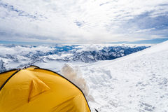 Camping in Caucasus Mountains on Elbrus landscape. Expedition camping in tent on Mount Elbrus trail to the top, Mountain landscape in autumn or winter in royalty free stock photo