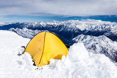 Camping in Caucasus Mountains on Elbrus landscape. Expedition camping in tent on Mount Elbrus trail to the top, Mountain landscape in autumn or winter in Royalty Free Stock Images