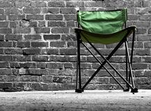 Camping Chair. In front of brick wall stock images