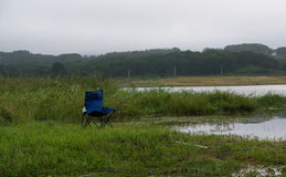 Camping chair at lake side Royalty Free Stock Photography