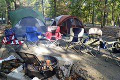 Camping chairs, tents. Camping chairs and tents on the campground at the Morrow Mountain State Park Royalty Free Stock Photography