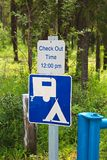 A camping check out time 12:00 pm message sign.  Stock Photos