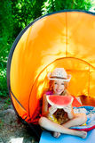 Camping children girl in tent Stock Images