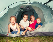 Camping. Children in a tent. Camping. Happy kids at summer vacations Stock Photos