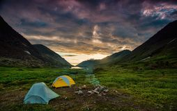 Camping in the chugach. Tent camping in a grassy valley in the chugach state park of alaska royalty free stock image