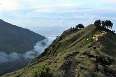 Camping in the clouds on the crater of mt Rinjani Stock Photo