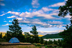 Camping Colorado Evening with Tent and Lake side View Royalty Free Stock Photo