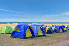 Camping and colorful tents Stock Photos
