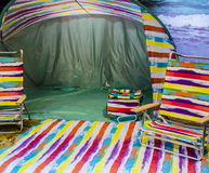 Camping. Colors tent, beach chair stock photo