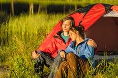 Camping couple enjoying sunset Stock Photos