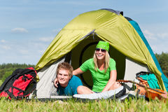 Camping couple lying inside tent summer Stock Images