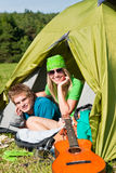 Camping couple lying inside tent summer Stock Photos