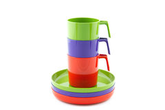 Camping cup and saucers on a pile Royalty Free Stock Photos
