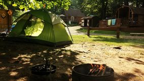 Camping on Delaware river. Tent and fire on a campground on Delaware river Stock Images