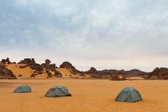 Camping in the Desert, Akakus, Sahara, Libya. Three tents in the sand. Camping in the desert - Akakus (Acacus) Mountains, Sahara, Libya royalty free stock photography