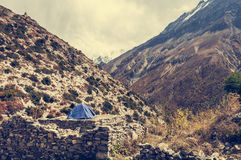 Camping on a deserted ruins in the mountains. Annapurna region in Nepal Royalty Free Stock Image