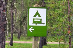 A camping direction sign with an arrow stock photo