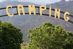 Camping entrance sign. Large camping entrance sign on mountain landscape Stock Photography