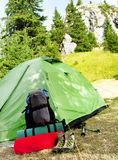 Camping Equipment on Nature Mountain Background Royalty Free Stock Image