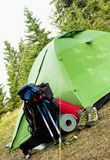 Camping Equipment with Tent, Backpack and Boots Royalty Free Stock Photography