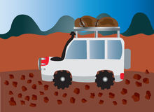 Camping expedition 2. An adventurer driving along a rough road Royalty Free Stock Photo