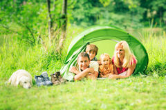 Camping Family. A family is camping by the lakeside stock photo