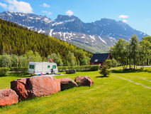 Camping field with camper under the rocky mountains. Norway Stock Images