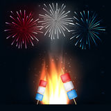 Camping fire with american flag marshmallows colors on stick. And fireworks.4th of july background Royalty Free Stock Photo