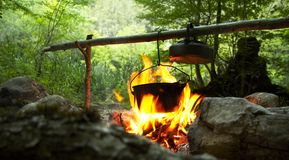 Camping fire. And kettle royalty free stock photo