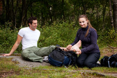 Camping First Aid. A couple camping and putting on a leg bandage stock photography
