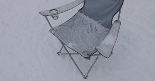 Camping folding chair in winter.  stock video