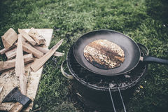Camping food. Baking a pancake for breakfest at a camping royalty free stock image