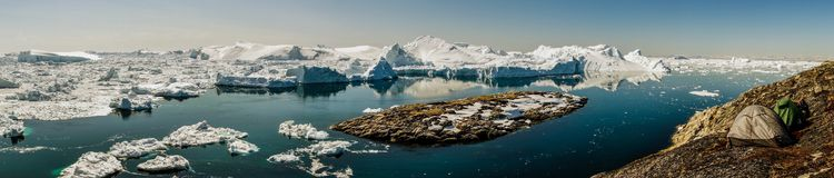 Camping in front of Icebergs. This is probably one of my favorite Campsites ever!! Just nnear Ilulissat in Greenland stock photo