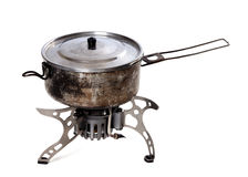Camping gas stove and old sooty hiking pan. Isolated on white background Royalty Free Stock Photo
