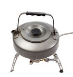 Camping gas stove and teapot Stock Photos