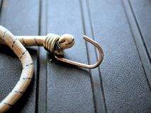 Camping gear: bungee cords on rugged black background royalty free stock photography