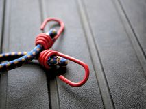 Camping gear: bungee cords on rugged black background Royalty Free Stock Photos
