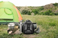 Camping gear and tourist tent in wilderness. Tourist equipment. Camping gear and tourist tent in wilderness stock image