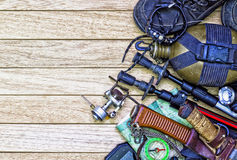 Camping gear, on wooden background. Stock Photography