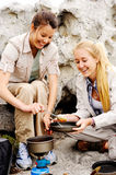 Camping girls with food Stock Photos