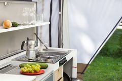 Camping or glamping. With a kitchen in a tent royalty free stock photos