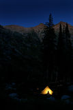 Camping in Glowing Tent at Night in Mountains Royalty Free Stock Images
