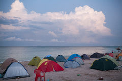 Camping ground on a beach next to the sea Stock Photos