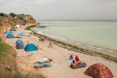 Camping ground on a beach next to the sea Royalty Free Stock Images
