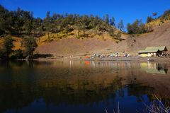 Camping Ground of Ranu Kumbolo. Ranu Kumbolo is a lake and best camping ground at 2,400 masl, inside of Bromo Tengger Semeru National Park. All climbers are stock photography