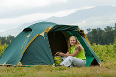 Camping happy woman Stock Images