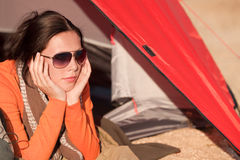 Camping happy woman lying in tent alone Royalty Free Stock Images