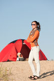 Camping happy woman outside tent on beach Stock Photo
