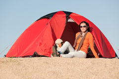 Camping happy woman sitting front of tent Stock Photography