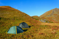 Camping in high mountains Stock Images